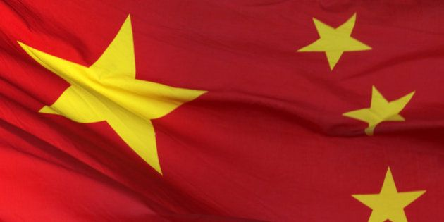 A Chinese national flag flies outside a department store in Beijing, China, on Sunday, Nov. 11, 2012....