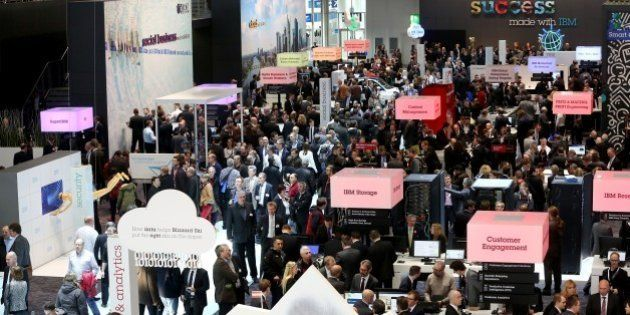 HANOVER, GERMANY - MARCH 16: Visitors walk around the International Business Machines (IBM) Company's...