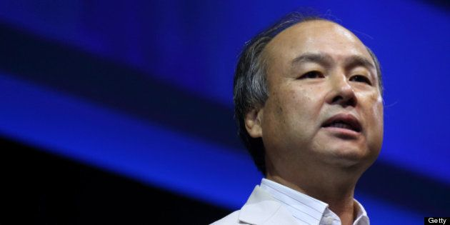 Masayoshi Son, chairman and chief executive officer of SoftBank Corp., speaks at the SoftBankWorld 2013...
