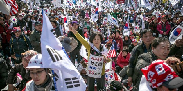 SEOUL, SOUTH KOREA - MARCH 10: Supporters of President Park Geun-hye react emotionally as the Constitutional...