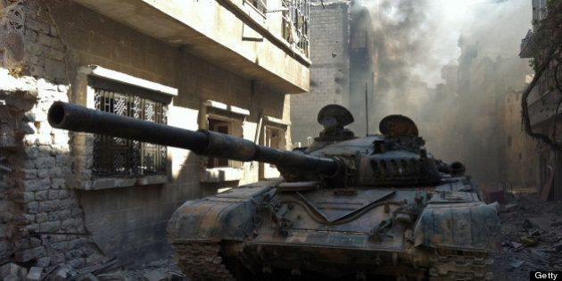 A government forces tank is seen in the Khalidiyah neighbourhood of Syria's central city of Homs on July...