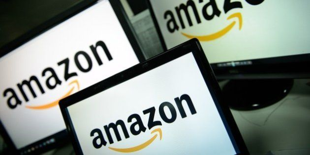 A picture shows the logo of the online retailer Amazon dispalyed on computer screens in London on December...