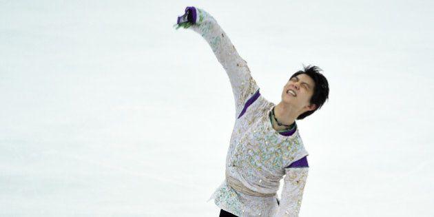 Yuzuru Hanyu of Japan reacts after his performance during the men's singles free skating at the ISU Grand...