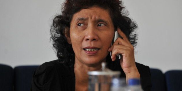 The owner of Indonesian scheduled and charter airline Susi Air, Susi Pudjiastuti, speaks over the phone...