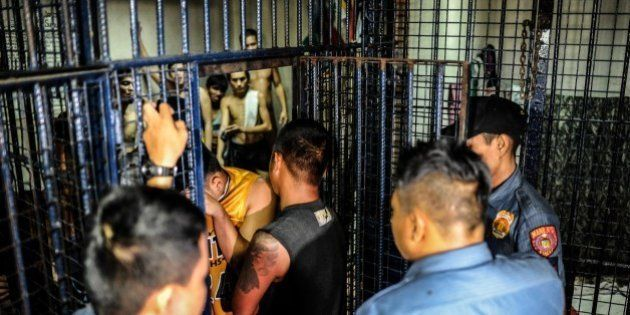 MANILA, PHILIPPINES - JUNE 20: Drug suspects are led into a crowded jail cell on June 20, 2016 in Manila,...