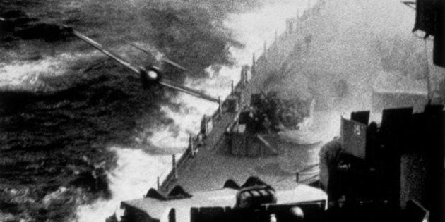 A Japanese kamikaze pilot tries to crash his plane loaded with bombs onto the deck of a US Pacific Fleet...