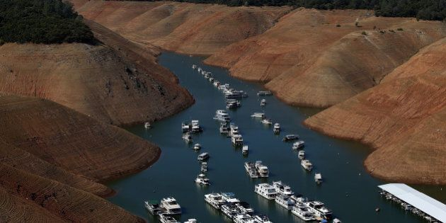 OROVILLE, CA - AUGUST 19: House boats are dwarfed by the steep banks of Lake Oroville that used to be...