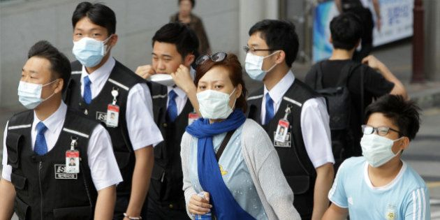 SEOUL, SOUTH KOREA - JUNE 02: People wear masks as a precaution against the MERS virus on June 2, 2015...
