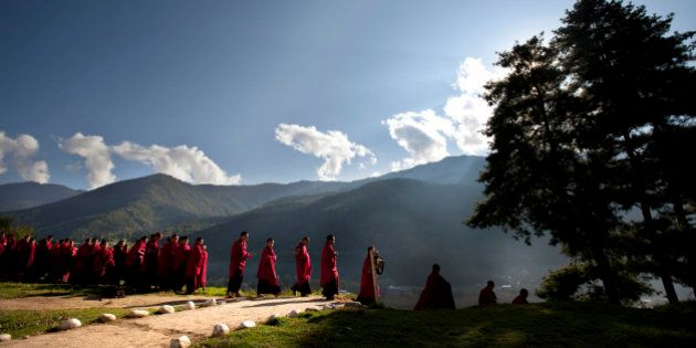 Bhutanese novice Buddhist monks walk to breakfast at a monastery in the capital of Thimphu, Bhutan, Wednesday,...
