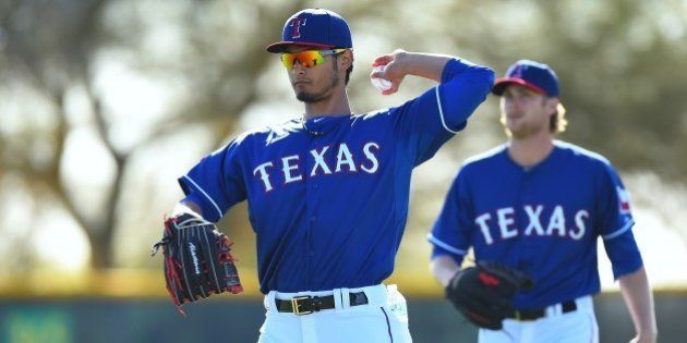 SURPRISE, AZ - MARCH 08: Yu Darvish #11 of the Texas Rangers works out during the spring training at...