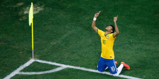 SAO PAULO, BRAZIL - JUNE 12: Neymar of Brazil celebrates scoring his second goal on a penalty kick in...