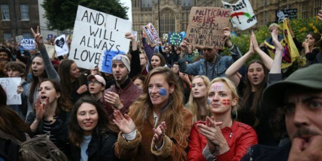 Demonstrators chant and clap on College Green outside The Houses of Parliament at an anti-Brexit protest...