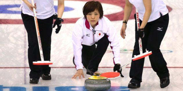 SOCHI, RUSSIA - FEBRUARY 11: Michiko Tomabechi and Chinami Yoshida of Japan of Japan sweep the ice as...