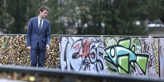 Paris Deputy Mayor Bruno Julliard stands on the Pont des Arts during the removal of love padlocks attached...