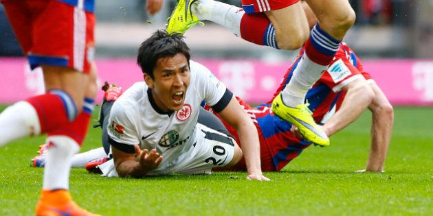 Frankfurt's Makoto Hasebe from Japan lies on the ground during the German first division Bundesliga soccer...