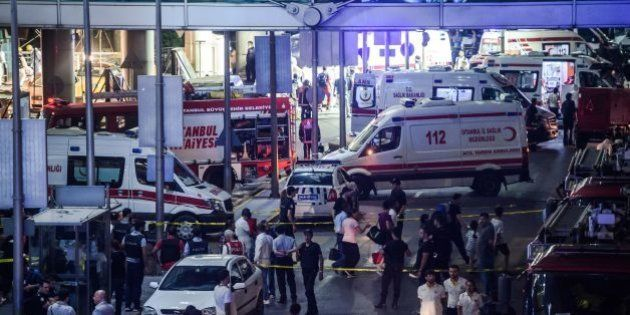 Forensic police work the explosion site at Ataturk airport on June 28, 2016 in Istanbul after two explosions...