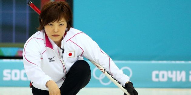 SOCHI, RUSSIA - FEBRUARY 14: Ayumi Ogasawara of Japan delivers the stone during the Curling Women's Round...