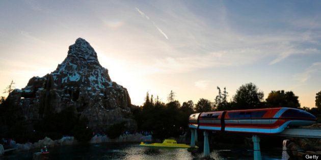The Monorail rides past the Walt Disney Co. Finding Nemo submarine ride at Disneyland Park, part of the...