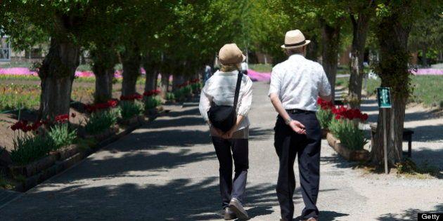 Japanese senior couple walking in
