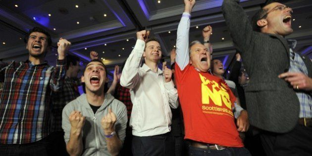 Pro-union supporters react as Scottish independence referendum results come in at a Better Together event...