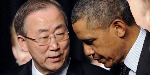 UN secretary general Ban Ki-moon chats with US President Barack Obama (R) after posing for a family picture...