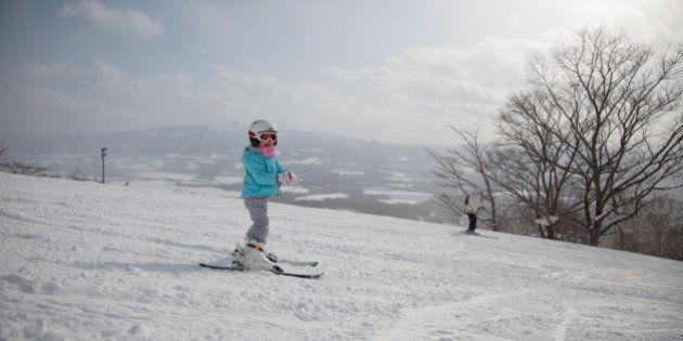 Japanese Child skiing in Niseko, Hokkaido,