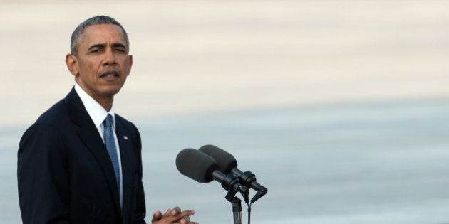 US President Barack Obama delivers a speech at the Hiroshima Peace Memorial park cenotaph in Hiroshima...