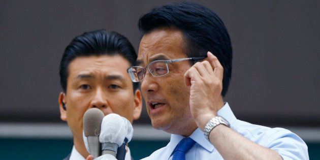 Japan's main opposition Democratic Party leader Katsuya Okada delivers a speech during an election campaign...