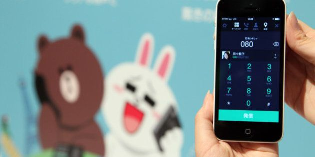 Line Corp.'s new call service is displayed on a mobile phone at a news conference in Tokyo, Japan, on...