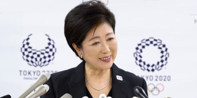 Yuriko Koike, governor of Tokyo, listens during a news conference in Tokyo, Japan, on Wednesday, Aug....