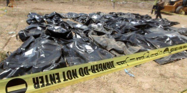 Body-bags containing the remains of people believed to have been slain by jihadists of the Islamic State...