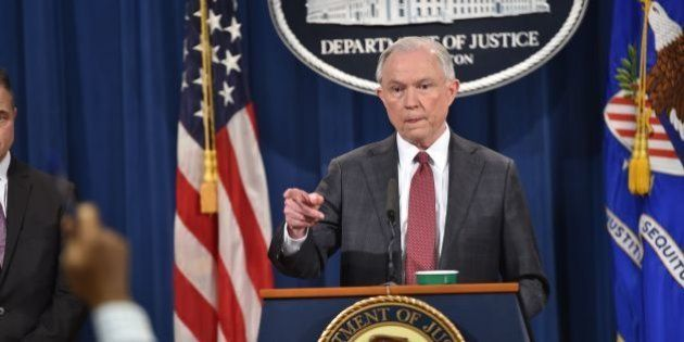 US Attorney General Jeff Sessions speaks during a press conference at the US Justice Department on March...