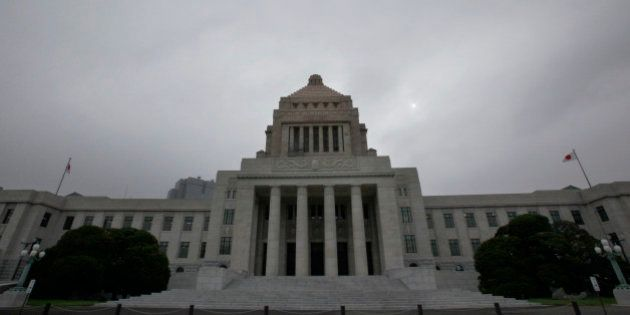 The Diet building stands at dusk in Tokyo Tuesday, July 13, 2010. The Democrats' ruling coalition enjoys...