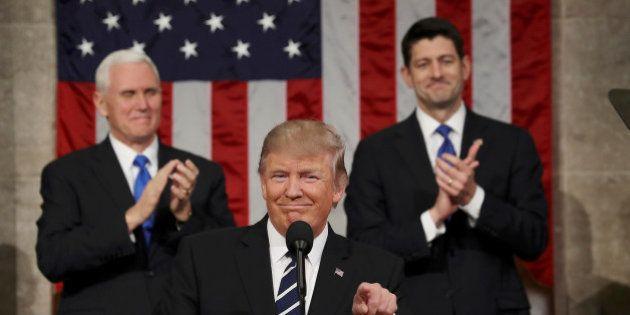 US Vice President Mike Pence (L) and Speaker of the House Paul Ryan (R) applaud as US President Donald...