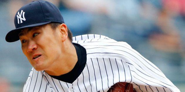 NEW YORK, NY - JUNE 05: Masahiro Tanaka #19 of the New York Yankees in action against the Oakland Athletics...