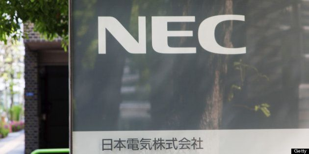 NEC Corp.'s logo is displayed in front of the company's headquarters in Tokyo, Japan, on Friday, April...
