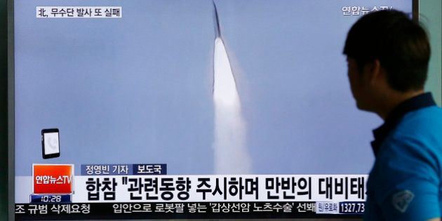 FILE - In this May 31, 2016, file photo, a man watches a TV news program reporting about a missile launch...