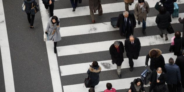 Pedestrians cross a road in Tokyo, Japan, on Friday, Feb. 24, 2017. Japan is responding to a government...