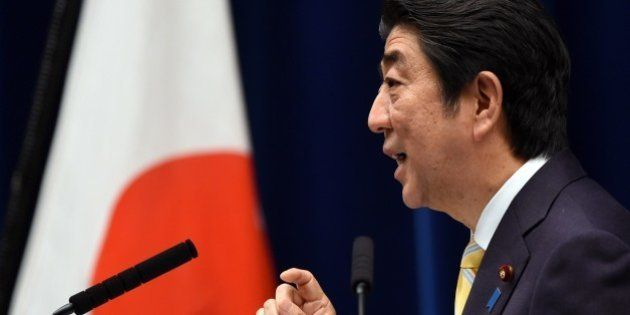Japan's Prime Minister Shinzo Abe delivers a speech during a press conference following a cabinet meeting...
