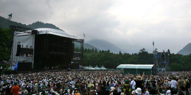 YUZAWA, JAPAN - JULY 26: People enjoy a concert during the Fuji Rock Festival at Naeba Ski Resort on...