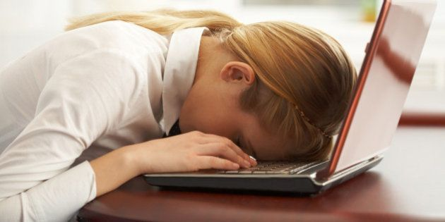 Image of very tired businesswoman or student with her face on keyboard of laptop Note to inspector: the...
