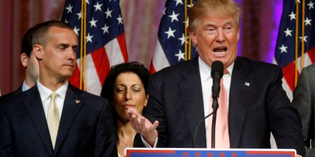 FILE - -In this March 15, 2016 file photo, Donald Trump's campaign manager Corey Lewandowski listens...