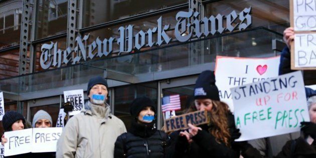 People take part in a protest outside the New York Times on February 26, 2017 in New York. The White...