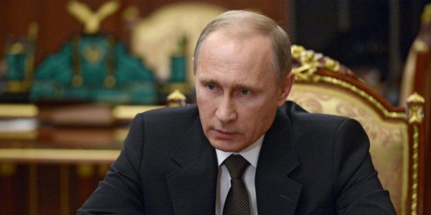 Russian President Vladimir Putin heads a meeting on Russian plane crash in Egypt in Moscow's Kremlin,...
