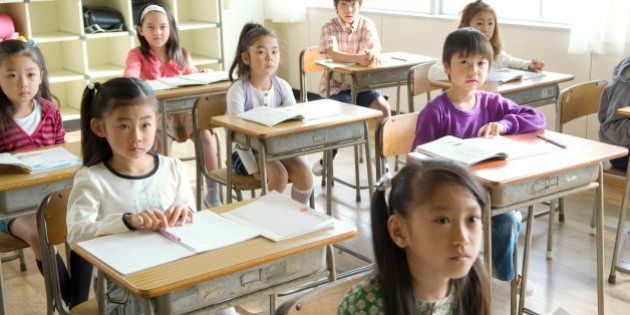 Students ( 6-11 ) listening