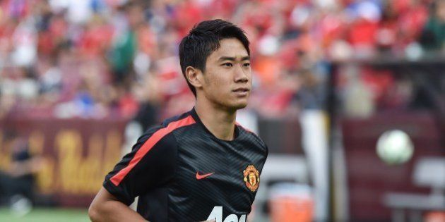 Manchester United's Shinji Kagawa smiles at fans before a Champions Cup match against Inter Milan at...