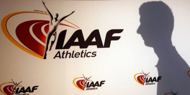 A man casts his shadow following a press conference by Sebastian Coe, IAAF's President, as part of the...