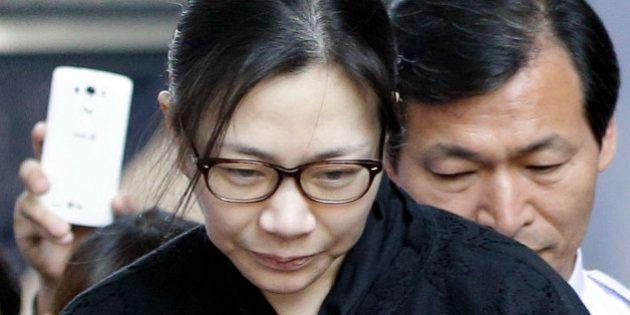 Former Korean Air executive Cho Hyun-ah, center, leaves the Seoul High Court in Seoul, South Korea, Friday,...