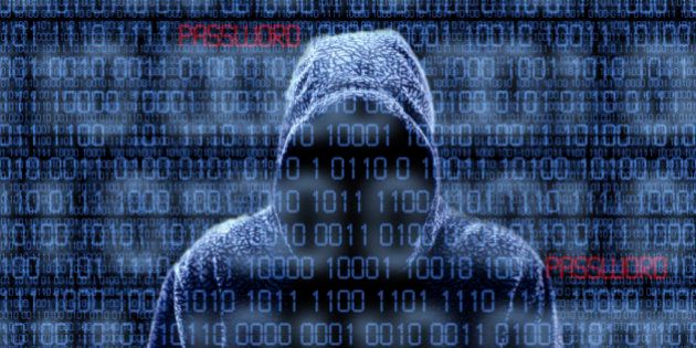 Silhouette of a hacker isloated on black with binary codes on