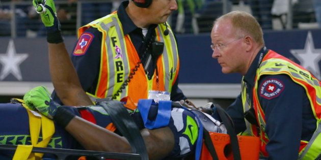 ARLINGTON, TX - NOVEMBER 01: Ricardo Lockette #83 of the Seattle Seahawks waves to fans while being carted...
